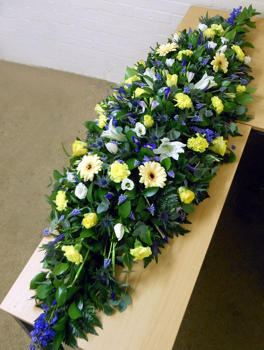 Blue & Yellow Funeral Coffin Spray