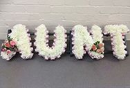 Funeral letters for an Aunt. Floral letters for an Aunt can be made by our florist in various colours with flowers arrangement