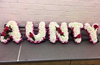 Funeral Letters to spell Aunty. This Aunty floral funeral letters can be created by our florists in various colours.