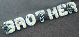 Stunning Brother Funeral Flowers Wreath. These funeral flower letters are 30cm high and our florists can make in any sizes. A wonderful funeral tribute
