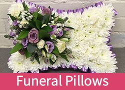 A funeral flowers pillow is created by florists using the flowers in flower foam to create a lovely last resting place.Can be delivered to Chelmsford or Witham or Braintree in Essex