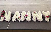 nanny funeral flowers letters. White letters for a funeral to spell Nanny