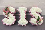 Sis funeral flowers letters tribute. Our florists will create your letters tribute in any colours. The sis wreath can be delivered to undertakers or church.