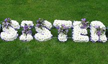 Sister funeral floral letters. Funeral letters are based with white Chrysanth and each funeral letter has a little flower arrangement across the sister tribute