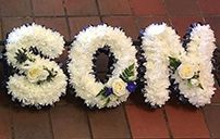 Son funeral flowers letters. Son wreath floral letters are based in white chrysanths with flower arrangements on each funeral letter